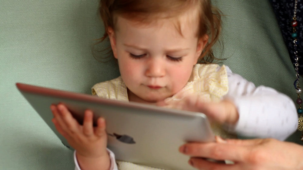 Child playing with iPad